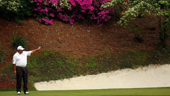Angel Cabrera of Argentina reacts to a putt on the 12th hole.