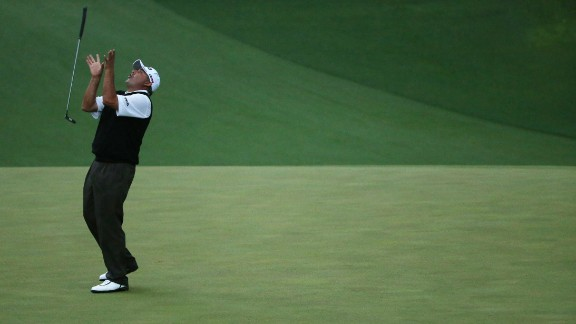 Angel Cabrera flips his putter after missing a birdie putt on the second sudden-death playoff hole.