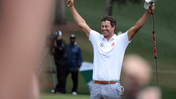 Adam Scott celebrates after he makes a birdie putt on the second sudden-death playoff hole.