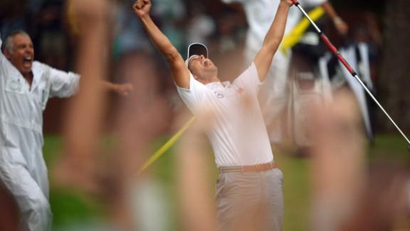 Adam Scott celebrates his win on the 10th hole.