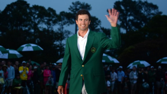 Adam Scott of Australia smiles while wearing the green jacket after winning the 2013 Masters Tournament at Augusta National Golf Club in Augusta, Georgia, on Sunday, April 14. Scott captured golf's most prestigious event in an oh-so-close sudden-death playoff with Angel Cabrera. Click through to see all the shots from the fourth day and look back at the third round.