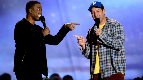 """The 2013 MTV Movie Awards came early this year, but Sunday night's show wasn't short on memorable moments. First up on the list? Chris Rock and Adam Sandler present the """"Best WTF Moment"""" award. Half of the segment was bleeped, with Rock keeping censors on their toes by appearing to say something off the cuff at the end."""