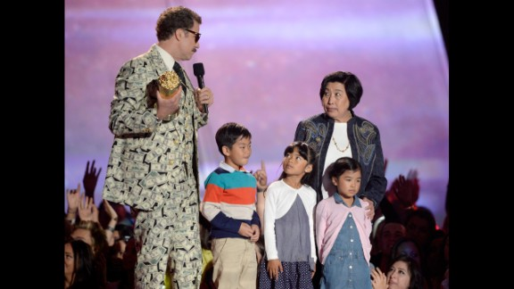 """""""Family man"""" Will Ferrell brings his """"amazing family"""" onstage as he accepts the Comedic Genius Award."""
