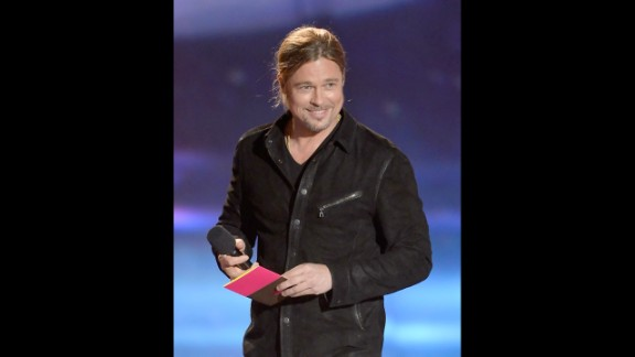 """Brad Pitt presents the movie of the year award to """"The Avengers."""""""