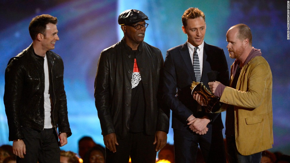 """The Avengers"" crew -- including Chris Evans, Samuel L. Jackson, Tom Hiddleston and Joss Whedon -- accept movie of the year honors, prompting director Whedon to show off his wit: ""What's the opposite of humbled?"" he asked. ""We're Biebered."""