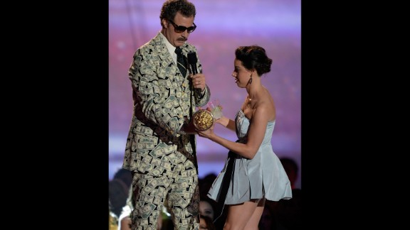 Aubrey Plaza provides the head-scratching moment of the night when she hops up on the stage and tries to take Will Ferrell's Golden Popcorn statue.