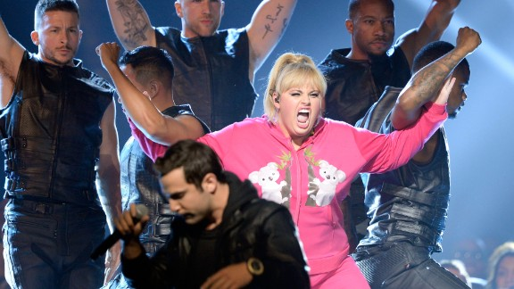 """Rebel Wilson reunites with the cast of her 2012 movie """"Pitch Perfect"""" for her opening number. She went on to wear a number of looks throughout the show."""