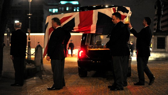 Pallbearers carry a coffin into St Clement Danes church during the rehearsal.