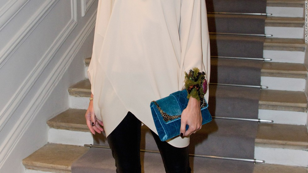 Olivia Palermo looks comfortable in leggings and a flowing tunic at a Dior fashion show.