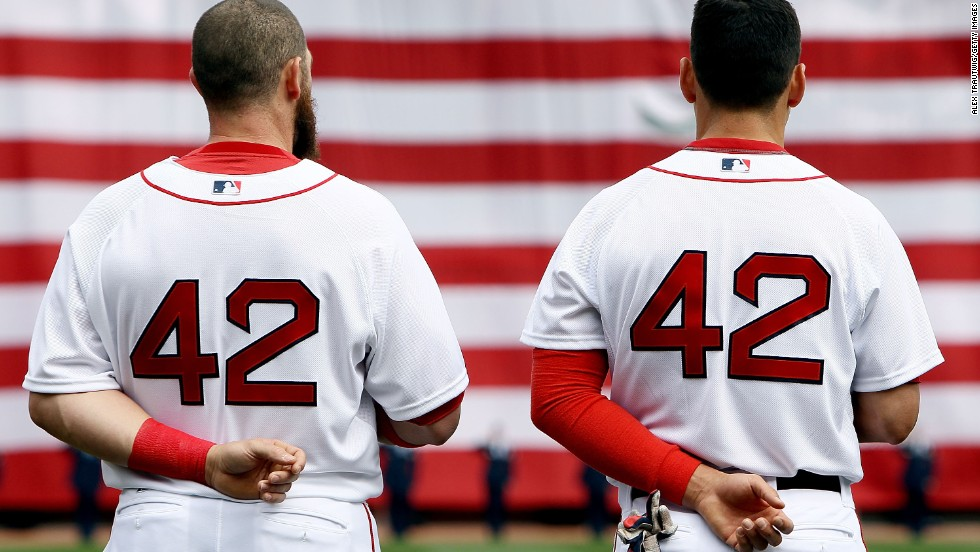 Jonny Gomes, left, and Jacoby Ellsbury of the Boston Red Sox stand for the national anthem before a game against the Tampa Bay Rays on  at Fenway Park in Boston.