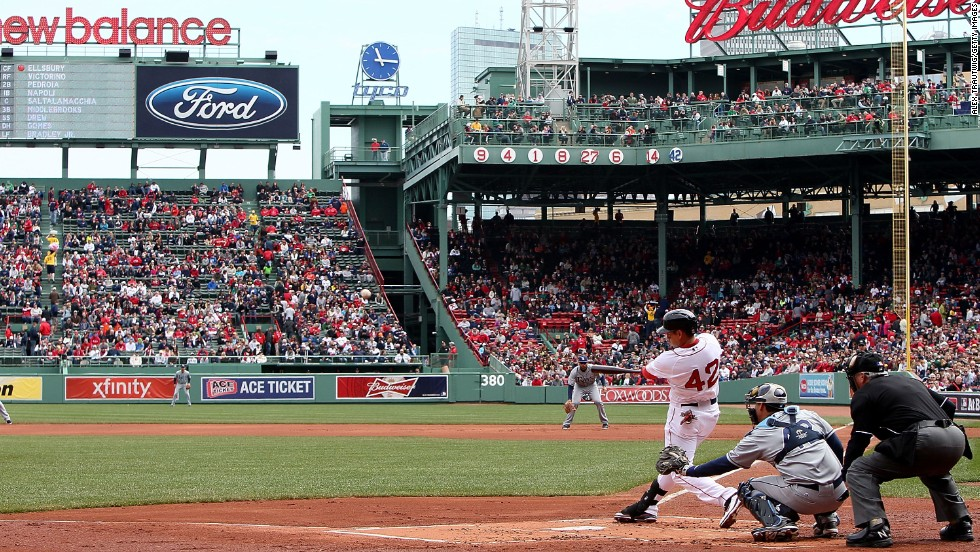Jacoby Ellsbury of the Boston Red Sox hits a triple against the Tampa Bay Rays in the first inning on April 15.