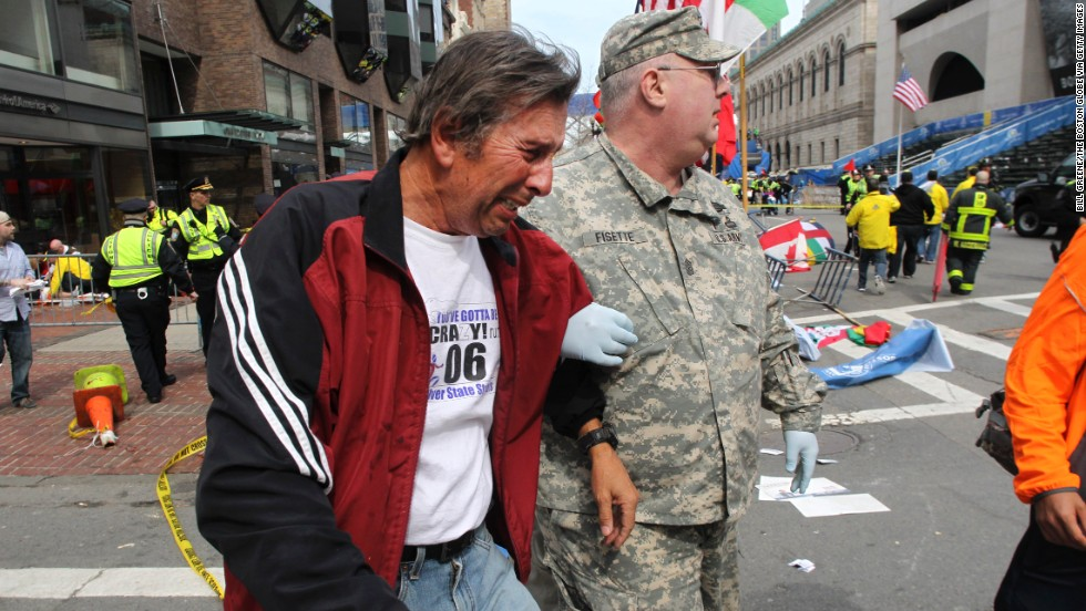 A man in tears is helped at the scene on Boylston Street.