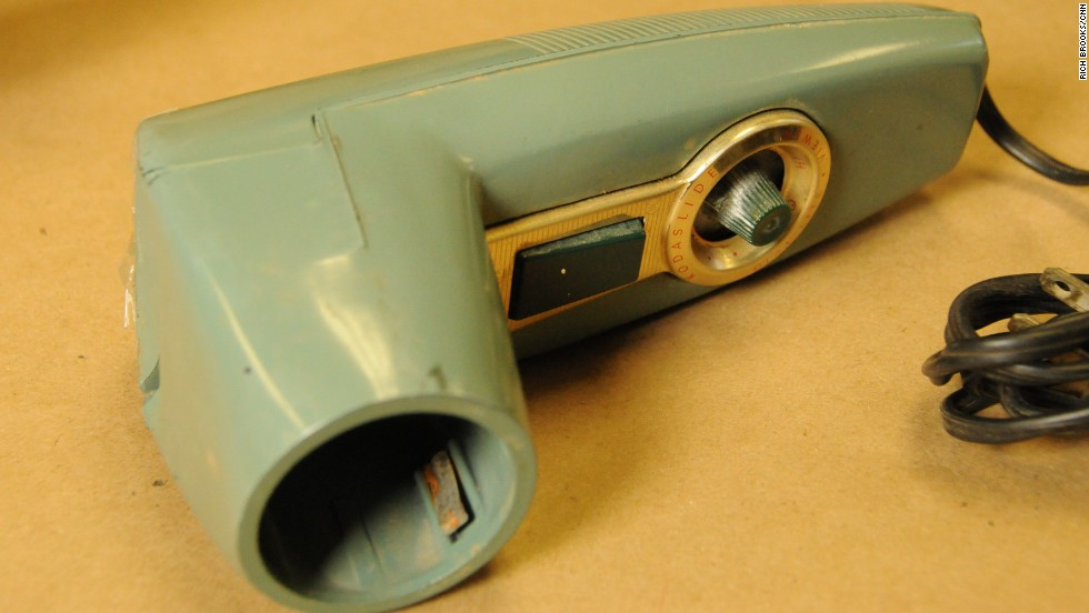 Next to Garza's body, police found this heavy Kodak metallic slide photo viewer, said former McAllen police officer Sonny Miller, who supervised crime scene investigations in 1960. Miller said investigators eventually learned the viewer belonged to the Rev. John Feit, a 27-year-old priest at Garza's church, Sacred Heart Catholic Church.<br />