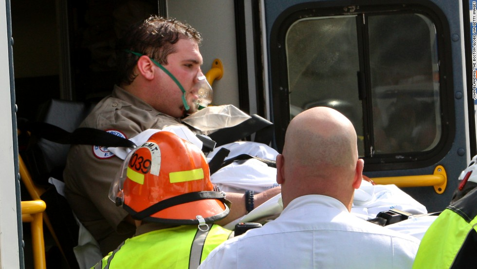 An EMT worker is transferred to an ambulance outside a medical tent in Copley Square.