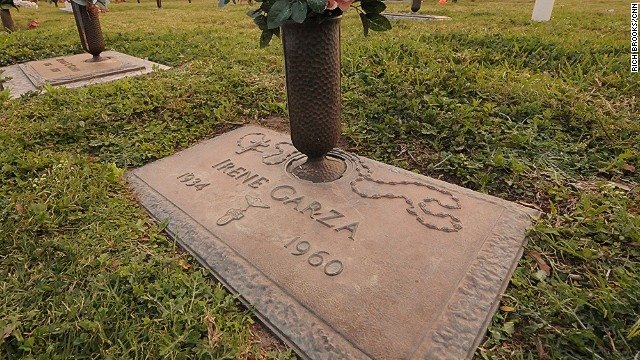 "Cousin Noemi Sigler visits Garza's grave. She has promised to ""never leave her behind."""