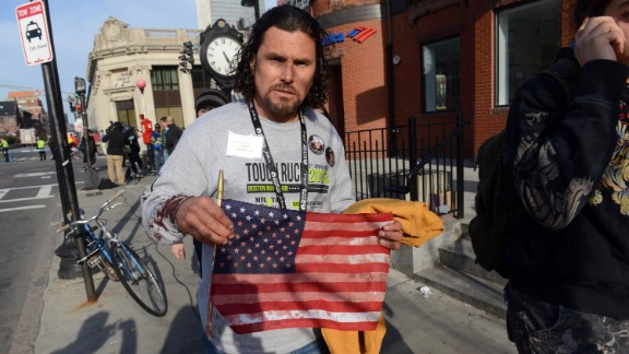 Carlos Arredondo was at the race handing out American flags to spectators. After the blasts, he helped emergency responders and is credited with helping a man survive serious leg wounds.