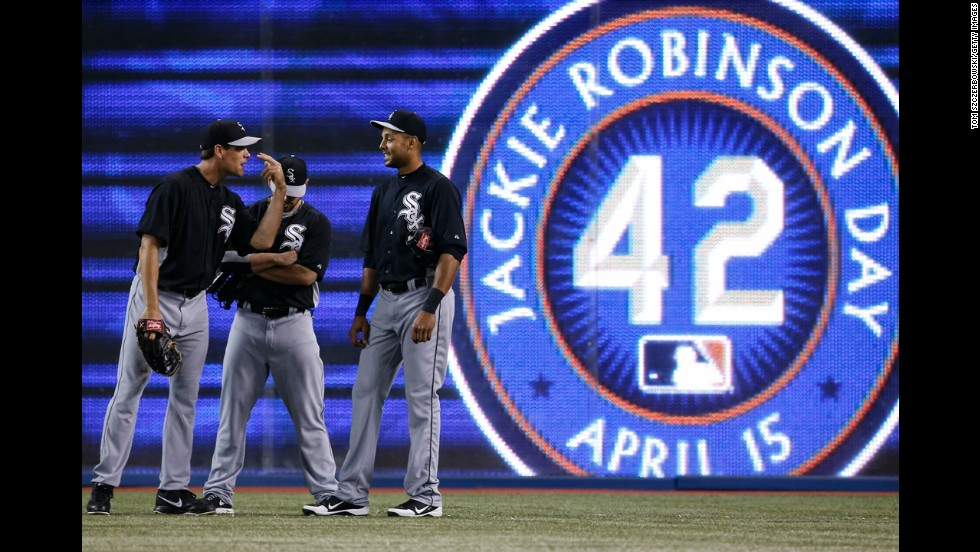 "Matt Thornton, left, and  Alex Rios of the Chicago White Sox wait in the outfield during batting practice before the start of the game against the Toronto Blue Jays at Rogers Centre on Monday, April 15, in Toronto, Ontario, Canada. All baseball players wore jerseys with No. 42 in honor of <a href=""http://inamerica.blogs.cnn.com/2013/04/15/opinion-its-jackie-robinson-day-but-black-boys-no-longer-dream-of-playing-baseball/"">Jackie Robinson Day</a>. The Brooklyn Dodgers great, whose story is told in the new movie <a href=""http://www.cnn.com/2013/04/02/showbiz/movies/jackie-robinson-movie-42/index.html"">""42,""</a> was the first African-American to play Major League Baseball in the modern era. Robinson broke the color barrier on April 15, 1947."