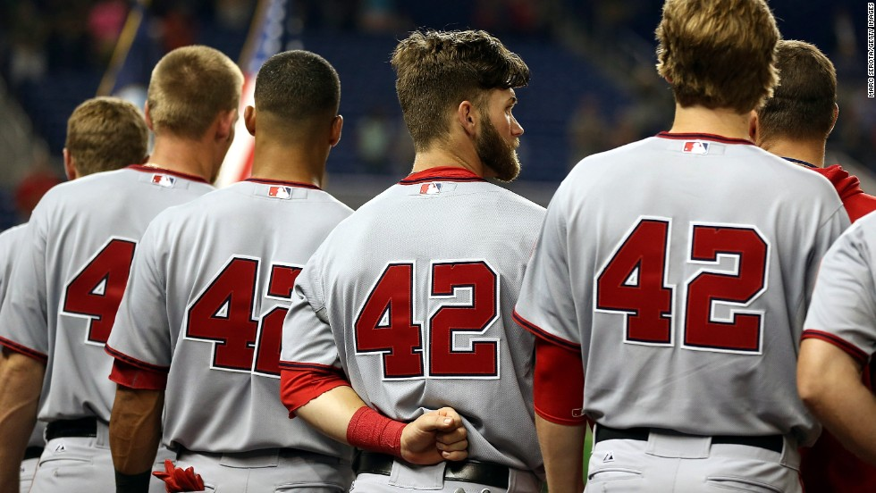 Players from the Washington Nationals stand for a moment of silence wearing Jackie Robinson's No. 42 before playing against the Miami Marlins at Marlins Park.