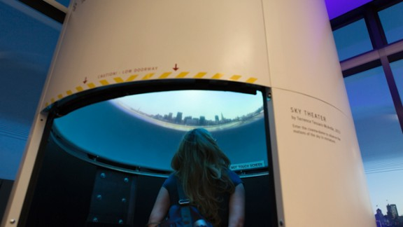A guest checks out the Sky Theater exhibit at the new Exploratorium.