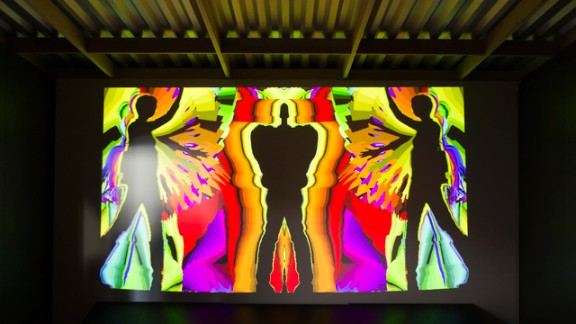 This artful screen shows colorful, time-delayed outlines of moving visitors.
