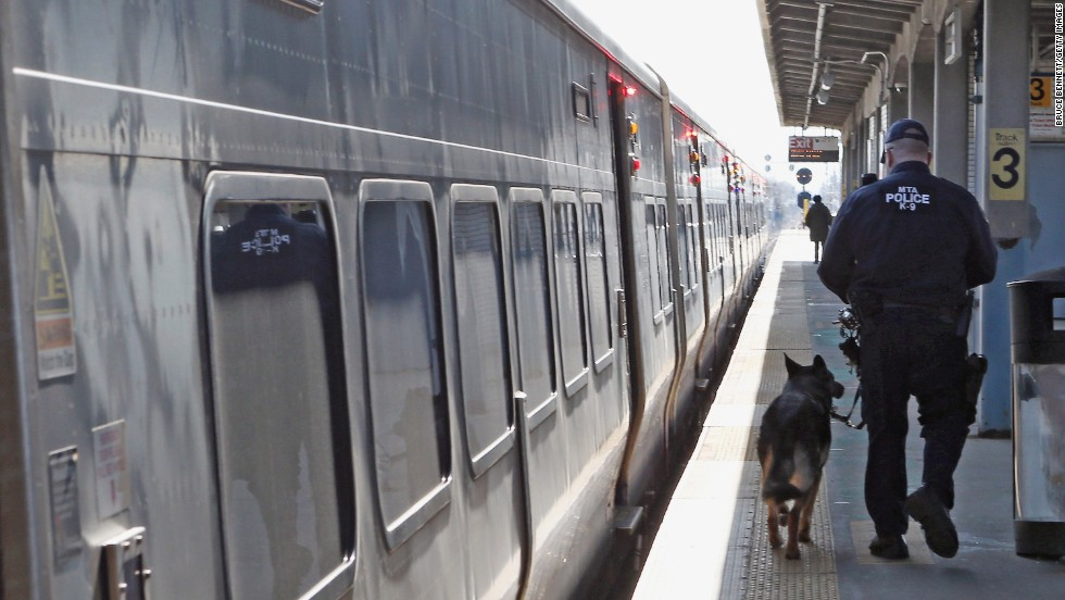 "A police officer and his dog guard a Long Island Rail Road train at the station in Hicksville, New York, on Monday. <a href=""http://www.cnn.com/SPECIALS/us/boston-bombings-galleries/index.html"">See all photography related to the Boston bombings.</a>"