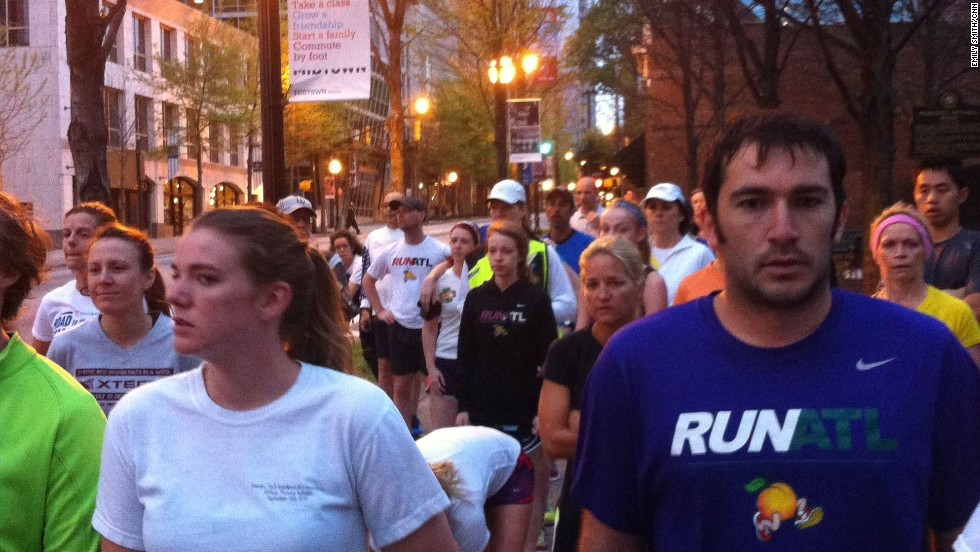 "<a href=""http://ireport.cnn.com/docs/DOC-957408"">CNN staff member Emily Smith</a> photographed Atlanta runners Tuesday morning running a silent mile in memory of those killed and injured in Monday's Boston Marathon blasts. ""It was an emotional morning, with many runners wearing Boston sports teams logos,"" she says."