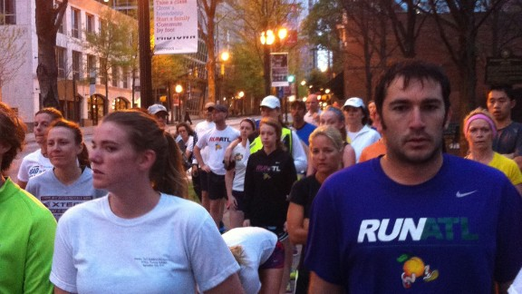 "CNN staff member Emily Smith photographed Atlanta runners Tuesday morning running a silent mile in memory of those killed and injured in Monday's Boston Marathon blasts. ""It was an emotional morning, with many runners wearing Boston sports teams logos,"" she says."