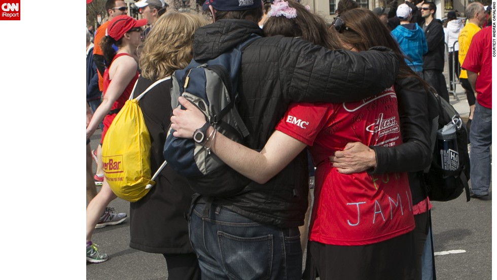 "<a href=""http://ireport.cnn.com/docs/DOC-957434"">Andrea Catalano</a>, a freelance photographer, shot this photo about a mile from the Boston Marathon finish line. He wanted to capture the outpouring of support from spectators and people in the area, comforting and assisting runners."