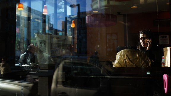 People have breakfast at a Boston cafe on April 16.