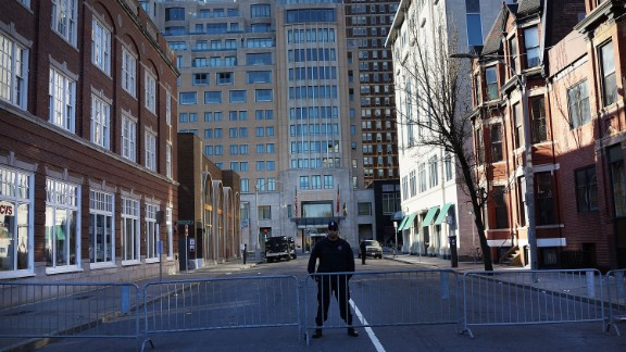 A Boston police officer stands near blast sites April 16.