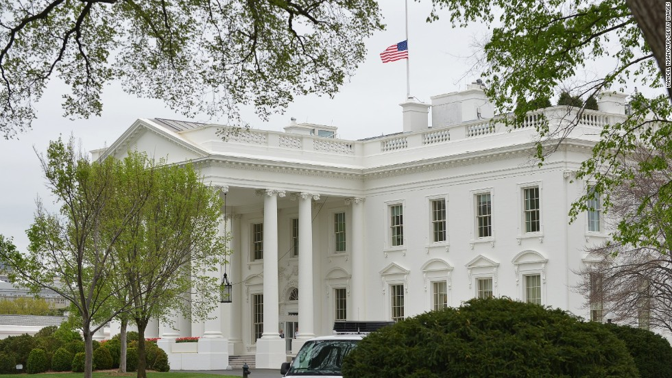 The flag above the White House flies at half-staff on April 16, 2013.