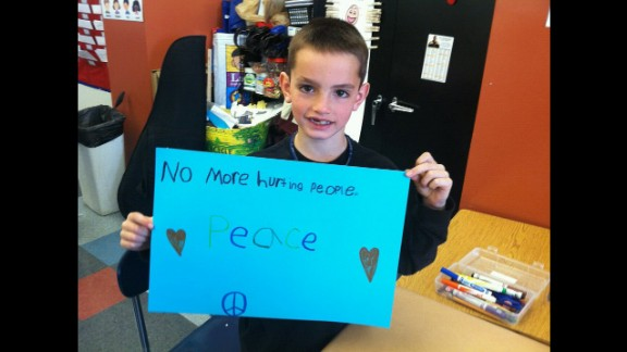 An image taken from Facebook shows Martin Richard, the 8-year-old killed after the second explosion at the Boston Marathon, holding a sign calling for peace.