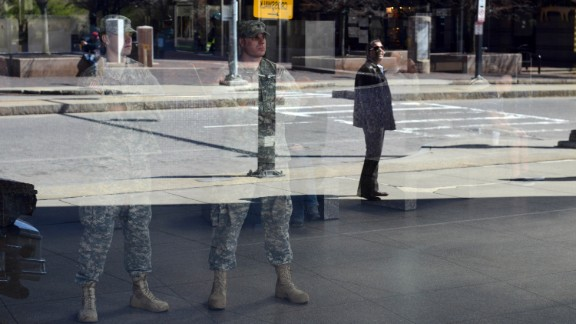 National Guardsmen look out from inside Boston