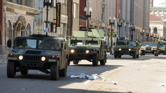 U.S. military Humvees move down deserted Boylston Street on April 16.