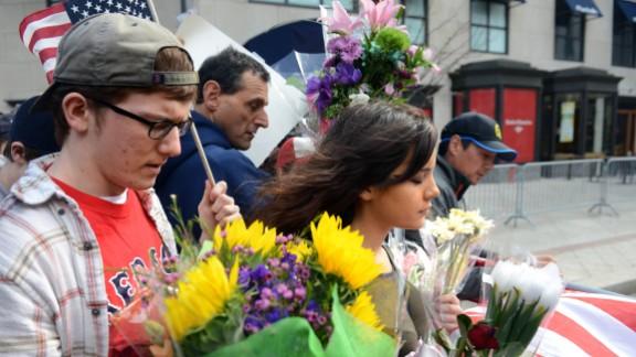 People walk along the barricade at Boylston Street on April 16, 2013.