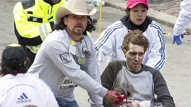 Man in cowboy hat helps injured
