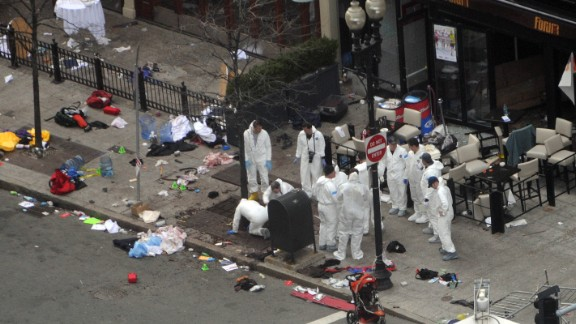 Investigators work at an area of the crime scene on Boylston Street on April 16.