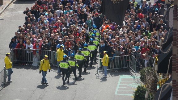 Officers enter the crowd.