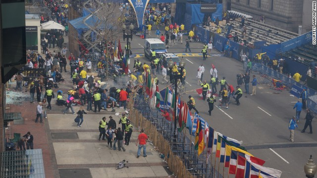 "Aaron Tang witnessed the Boston Marathon bombing from his office, which is a half block from the finish line. "" Big blast of fire, and smoke, but it all vanished so fast and not much left to see minus lots of shattered glass,"" he said on his Flickr album."