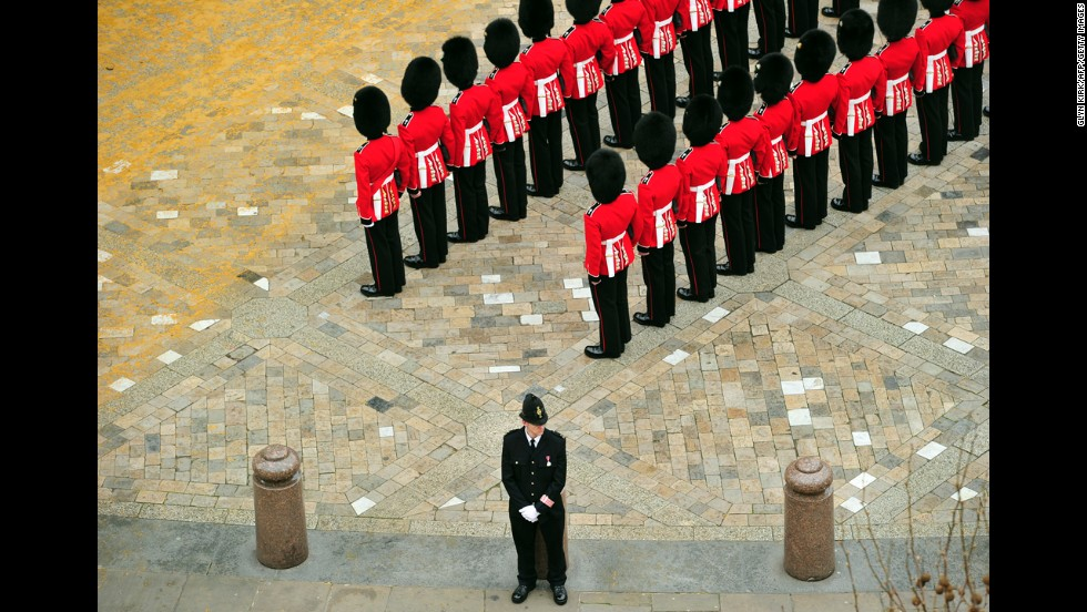 Guardsmen stand to attention outside St Paul's Cathedral.