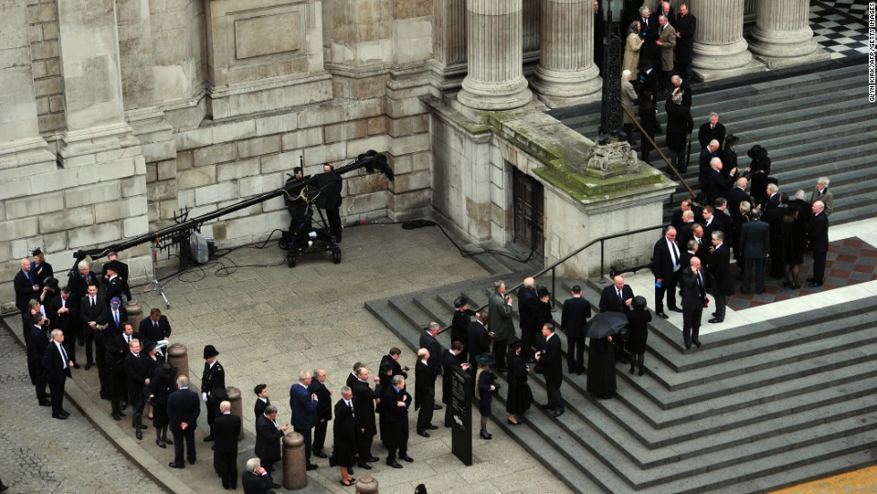 Mourners wait outside St Paul's Cathedral to attend Thatcher's ceremonial funeral.