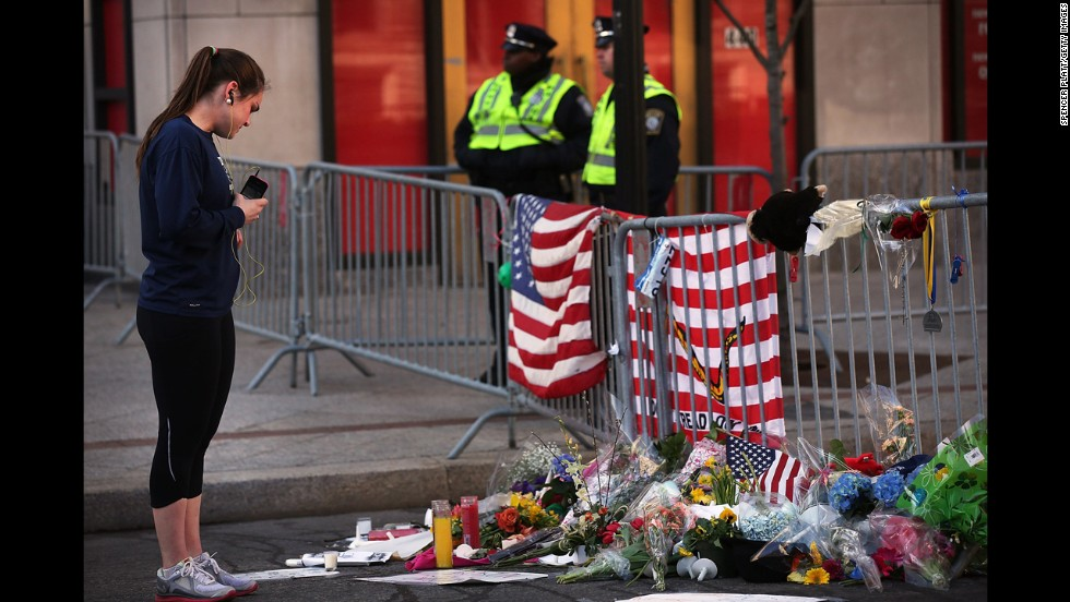 A woman looks at memorials left at the scene of the attack.