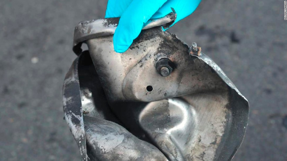 Boston Marathon bomb scene pictures, taken by investigators, show the remains of an explosive device.