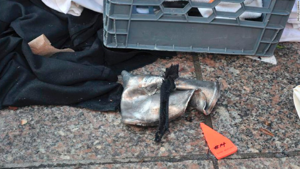 A federal law enforcement source with firsthand knowledge of the investigation told CNN that a lid to a pressure cooker -- thought to have been used in the bombings -- had been found on a roof of a building near the scene.