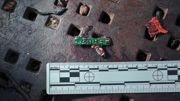 The recovered parts include part of a circuit board, which might have been used to detonate a device.