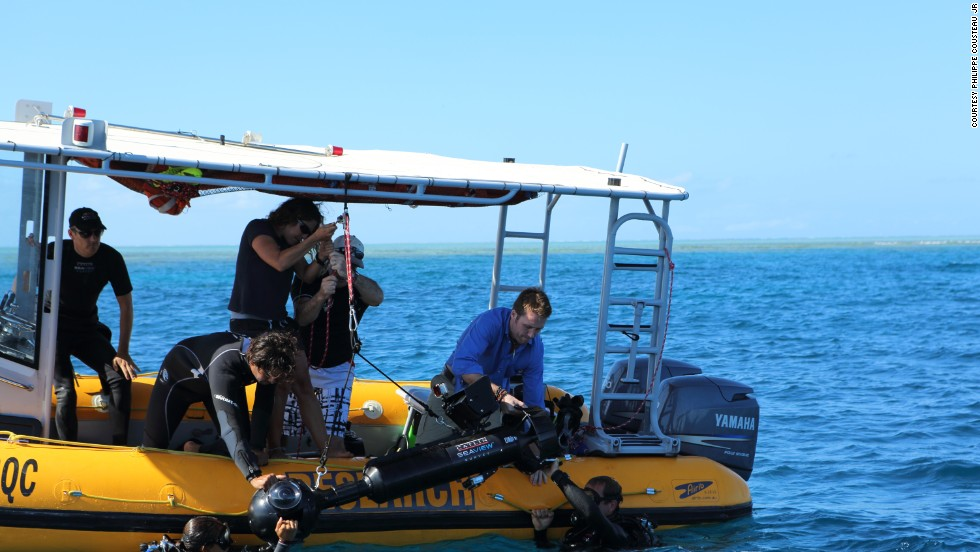 Philippe Cousteau and team prepare for a dive in waters off the Great Barrier Reef.