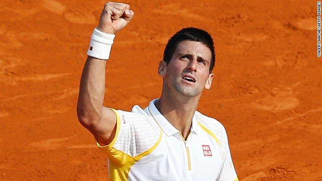 Novak Djokovic punches the air in relief after winning his second round match at the Monte Carlo Masters