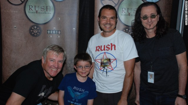 Ed Stenger and his son Zach meet Alex Lifeson, left and Geddy Lee, right, in Toronto, Canada.