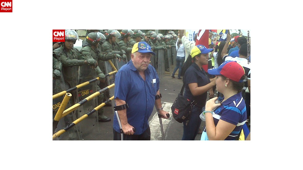 "<a href=""http://ireport.cnn.com/docs/DOC-957915"">Daniela Maggiolo</a> from Puerto Ordaz, eastern Venezuela, was moved by this image of an elderly protester outside the city's local office for the National Electoral Council office."