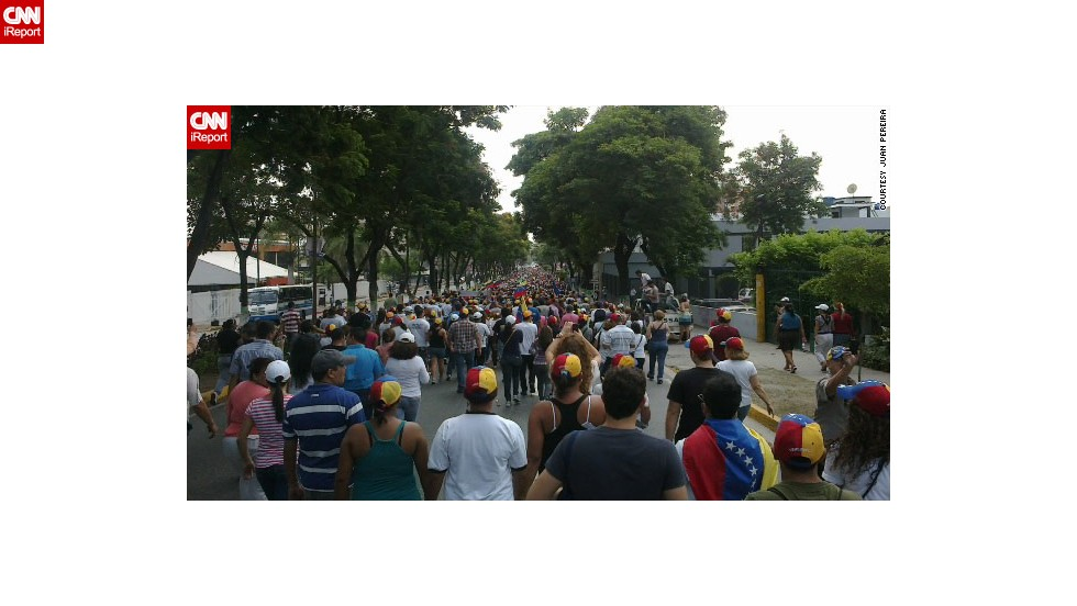 "Protests have not been confined to Caracas. In Barquisimeto, northwest Venezuela, iReporter Juan Pereira here joins an <a href=""http://ireport.cnn.com/docs/DOC-957665"">opposition march</a> to the National Electoral Council office to call for a recount. But offices were closed, he said."